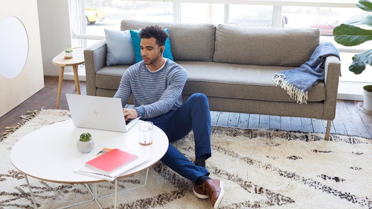 business man using HP laptop at home