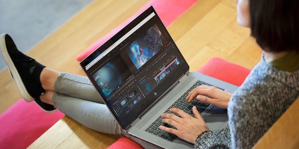 Lady using business laptop with powerful processor, graphics and speed